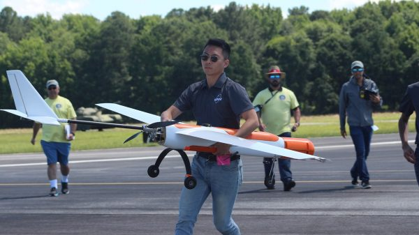 """Hyeonseung """"Shawn"""" Lee maneuvers Phoenix III, the competition aircraft of UT Austin's Unmanned Aerial Vehicle Team."""