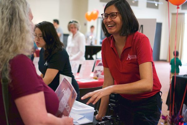 Sona Shah greeting guests at the Asian American Resource Center's fifth anniversary event in 2018.