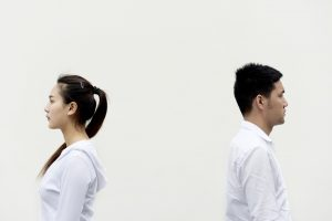 two people facing away from eachother