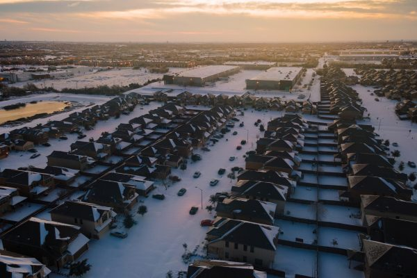 golden hour Sunrise over Texas Landscape covered in White Powder Snow during winter storm Uri