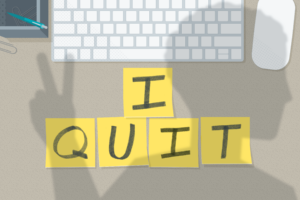 'I Quit' spelled out in sticky notes, with a shadow of someone walking away giving peace hand sign