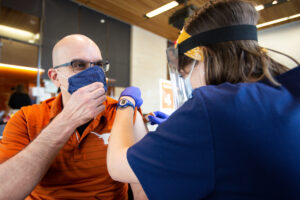 Social Work professor Ruben Parra-Cardona receives the Covid-19 vaccine in the Health Discovery Building at The University of Texas at Austin. Photo by Montinique Monroe